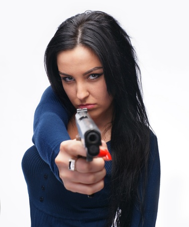 Young girl with a pistol on a white background photo