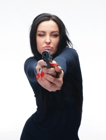 Young girl with a pistol on white background Stock Photo - 17259987