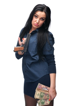Young girl with pistol and old money on a white background