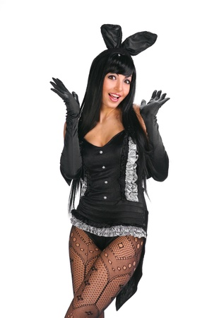 Sexy playgirl in bunny costume over white background Stock Photo - 17384744