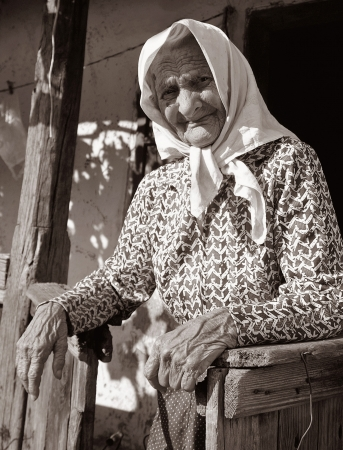 B&W portrait of very old woman in headscarf near her house Stock Photo - 17565808