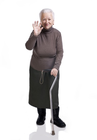 lame: Old woman with a cane on a white background