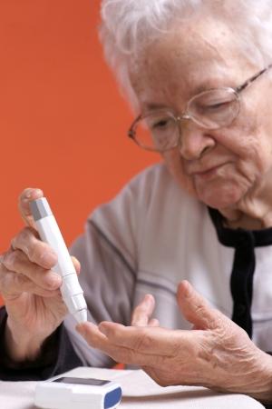 Senior woman checking sugar level