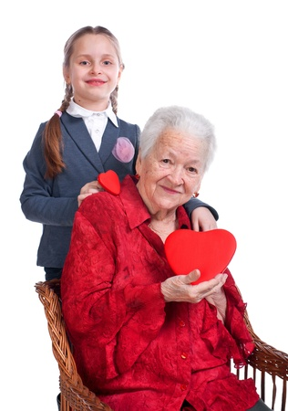 Granddaughter hugging her grandmother  on a white background Stock Photo - 17789217