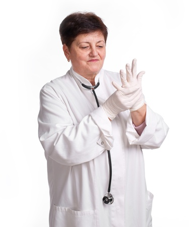 Senior doctor wearing latex gloves on a white background Stock Photo - 17891513