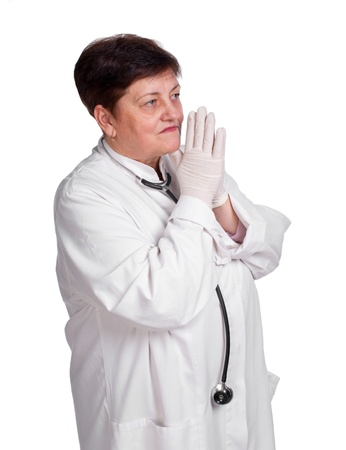 Senior doctor in latex gloves and with stethoscope  on a white background Stock Photo - 17891514