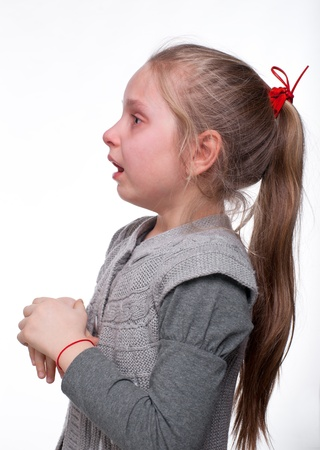 Scared little girl on a white background photo