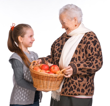 Grandmother with granddaughter with basket of apples on a white background Stock Photo - 17891519