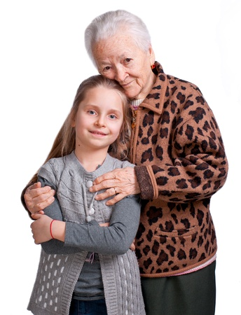 Grandmother hugging her granddaughter on a white background Stock Photo - 17897885