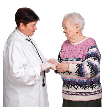 Old woman having discussion with her doctor on a white background photo