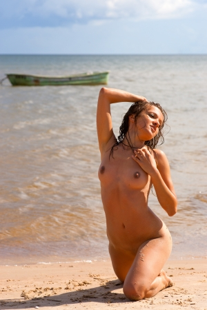 beach breast: Young nude woman sunbathing on the beach