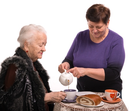 Mother having tea with her daughter on a white background Stock Photo - 18162759