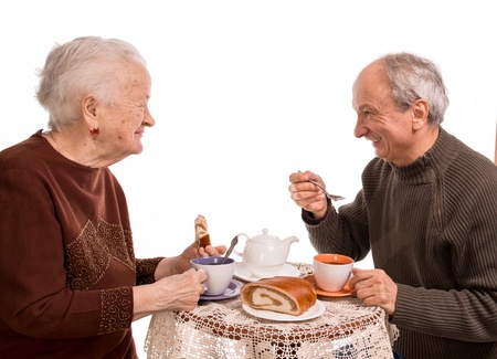 Mother having tea with her son on a white background Stock Photo - 18162754