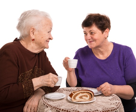 Mother having coffee with her daughter on a white background Stock Photo - 18162764