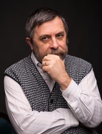 canny: Pensive elderly man on a dark background
