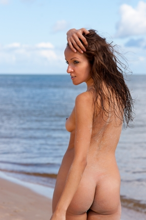Young naked woman on a sea background