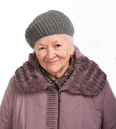 outwear: Portrait of  old woman in winter outwear on white background