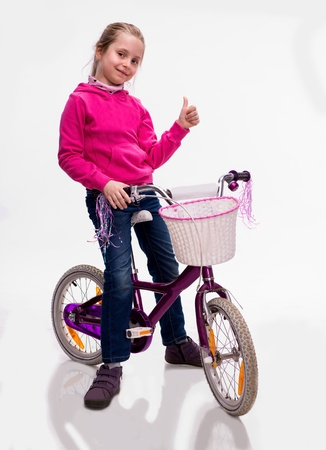 happy girl sitting on bicycle isolated on white background 免版税图像