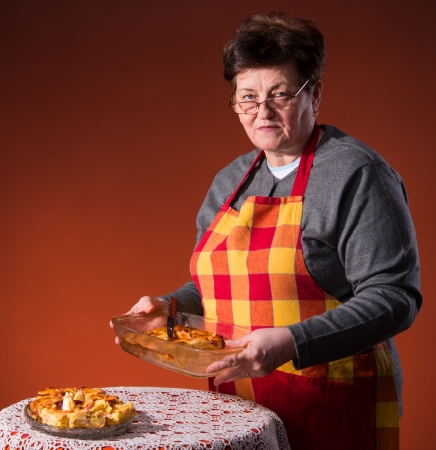 Mature woman preparing apple pie Stock Photo - 18442237