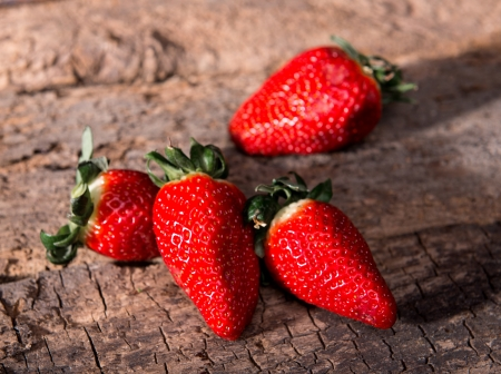 Strawberries over Wooden Background. Close-up.  photo