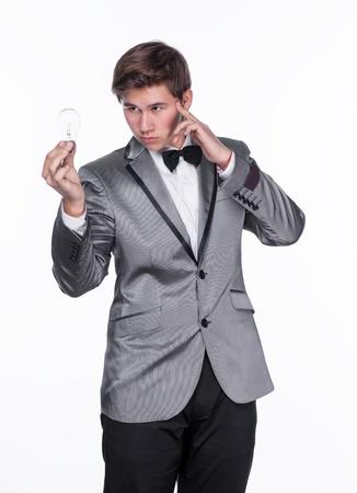 Magician using telekinetic powers on a white background 免版税图像
