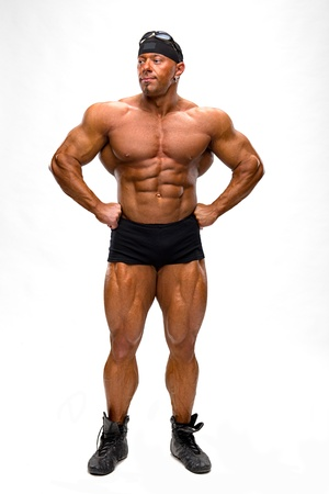 pectorals: Bodybuilder posing on a white background