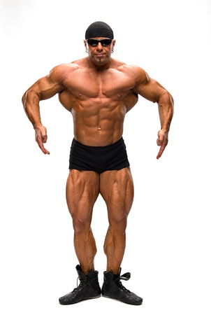 Bodybuilder posing on a white background
