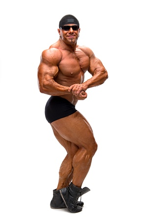 Bodybuilder posing on a white background
