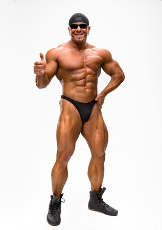 tricep: Bodybuilder posing on a white background