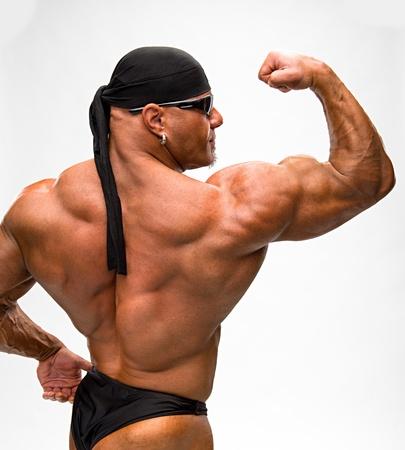 male bodybuilder: Portrait of bodybuilder on a white background