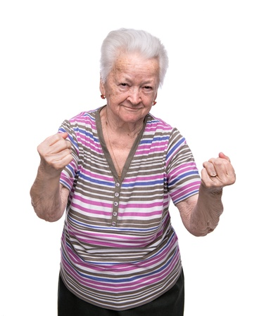 Angry old woman making fists on white background Stock Photo
