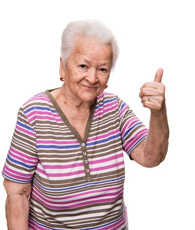 Old woman  showing ok sign on a white background photo