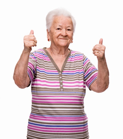 Old woman  showing ok sign on a white background 免版税图像