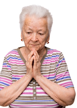 Old woman praying on a white background Banco de Imagens