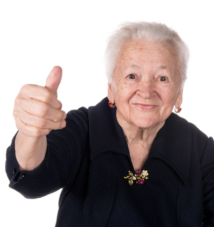 Old woman showing ok sign on a white background