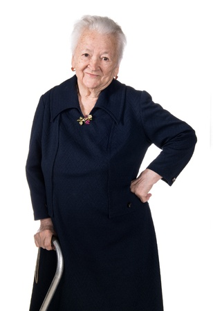 Smiling old woman sitting with a cane on a white background