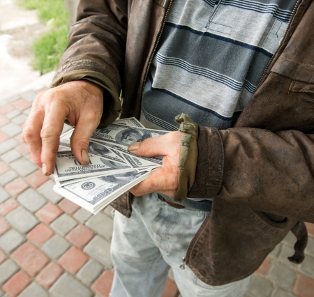 Farmers hands holding pack of money on natural background Stock fotó