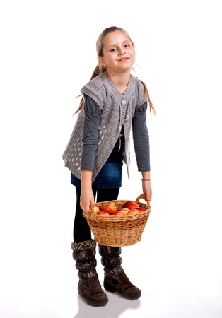 Pretty girl  with basket of red apples isolated on white background photo