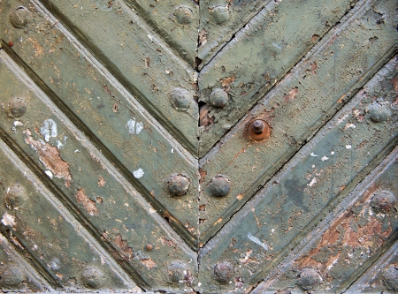 Ancient weathered door background texture with metal rivets. Old part of Krakow, Poland photo