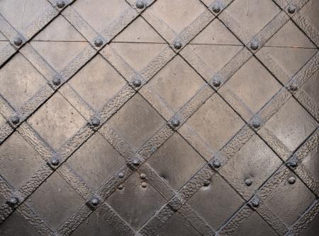 Ancient metal door background texture.Old part of Krakow, Poland photo