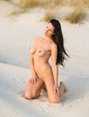 beach breast: Young nude woman posing on the beach