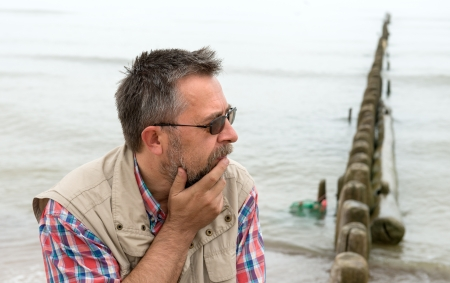 Side view of sad elderly man on the beach Stock Photo - 21445553