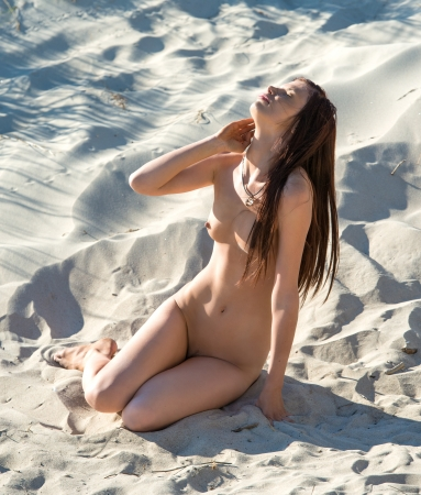 erotic nude women: Young nude woman posing on the beach