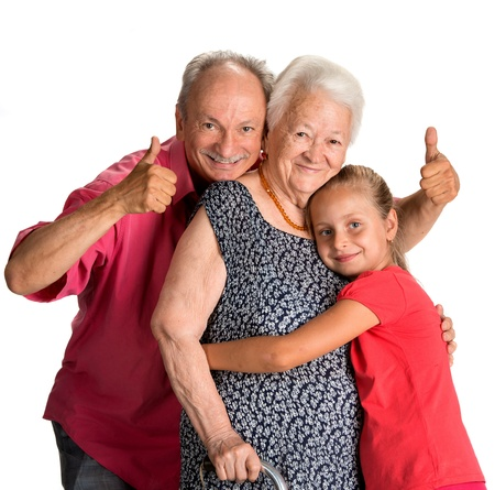 Happy multi-generation family on a white background