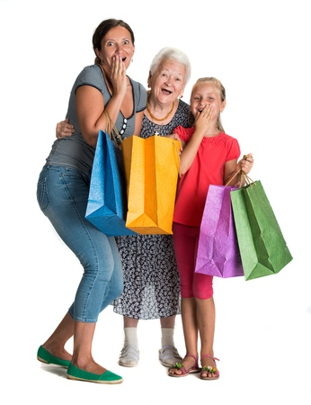Three generations of women with shopping bags on a white background photo