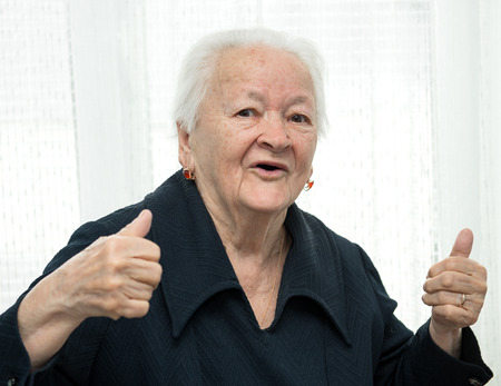 Old woman showing ok sign  photo