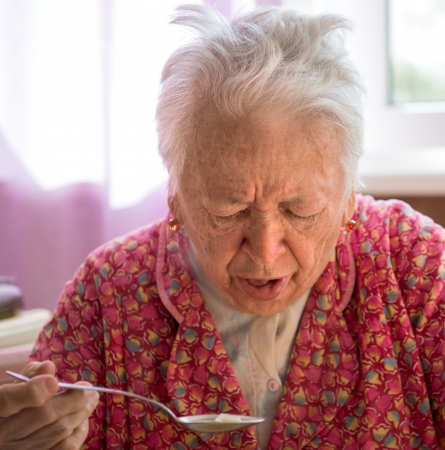 Portrair of old coughing  woman