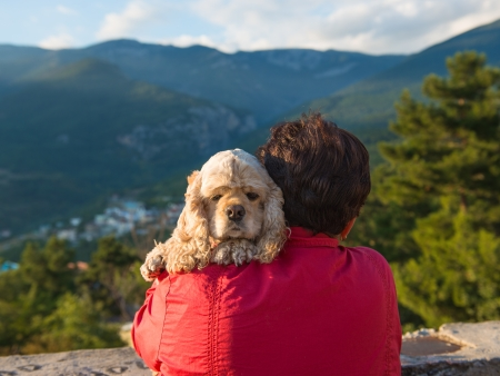 nape: Woman with american spaniel on the nature background