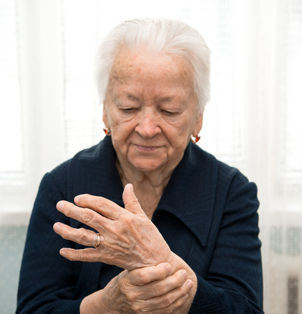 hypertensive: Old woman measuring her pulse