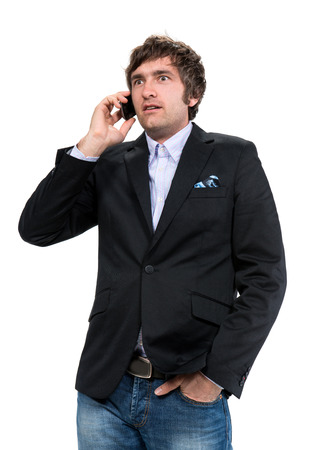 Shocked man with cell phone on a white background photo